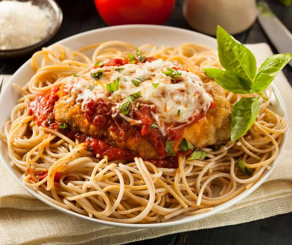 You must try this easy chicken parmesan recipe. It has a deliciously crispy coating, smothered tomato sauce, and melted mozzarella cheese!