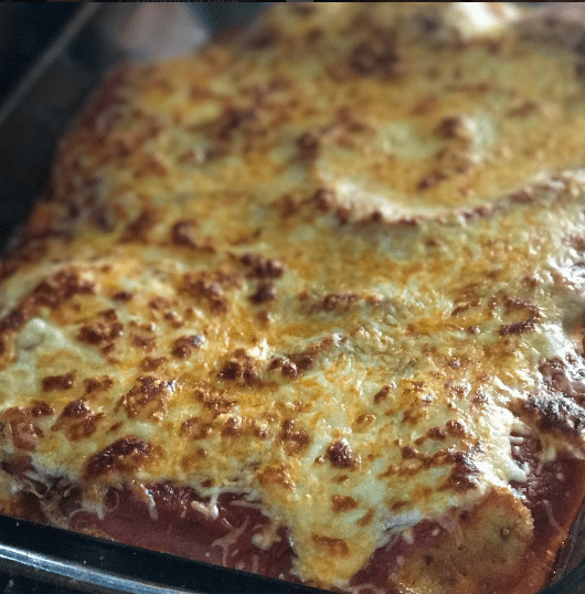 This is the best chicken parmesan recipe. It has a deliciously crispy coating, smothered tomato sauce, and melted mozzarella cheese!