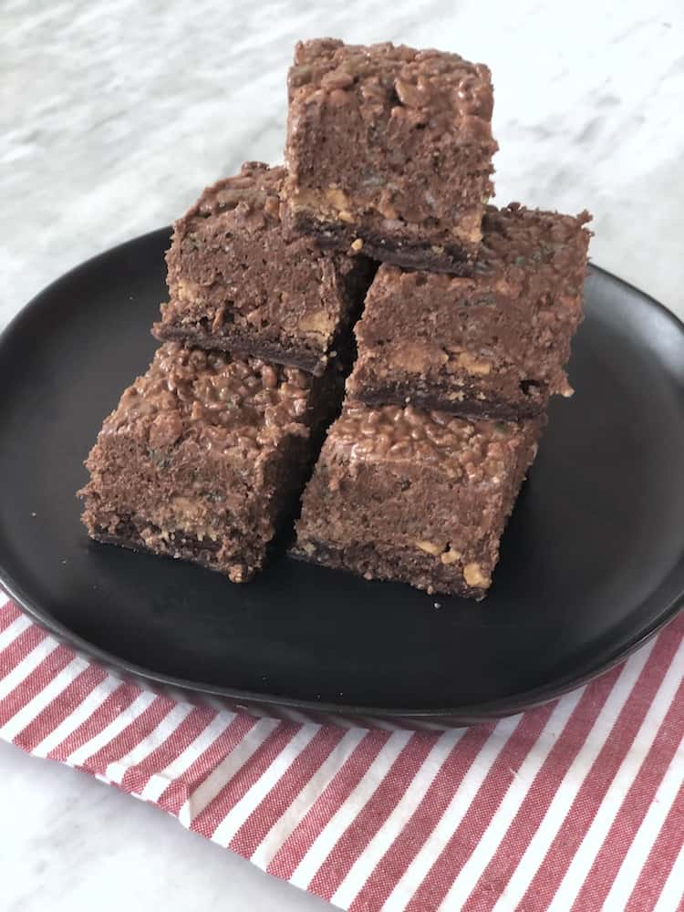 This is the Best Brownie Recipe! They are fudgy brownies made in a 9x13 pan topped with peanut butter cups, peanuts, and a Rice Krispy mixture made with more peanut butter and chocolate! It's super easy because you can use any boxed brownie mix.