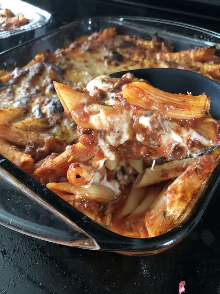 Anyone can make this easy baked ziti recipe with ground beef. It is simple enough for the novice chef and doesn't include ricotta cheese in the recipe. You get the creaminess with provolone cheese and sour cream. It's really delicious. It's the best recipe for a crowd or to bring to a friend. It's also a great freezer meal.