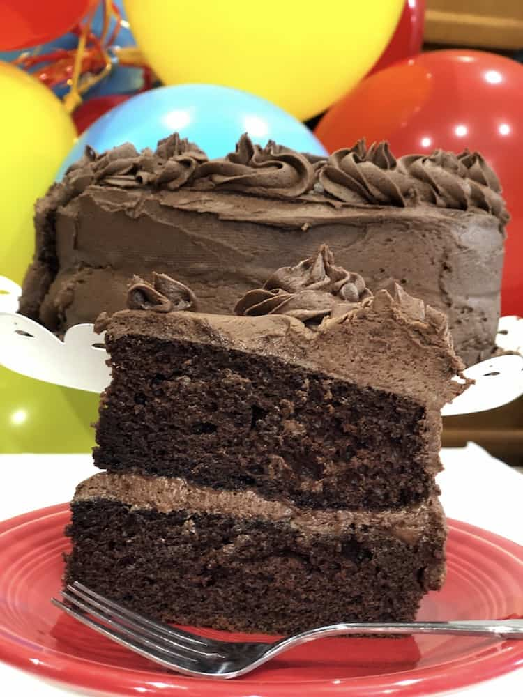 Are you looking for how to make a box cake mix taste better? This is the best chocolate cake recipe ever. It is so easy! It starts with a mix and is moist and yummy! With a few adjustments, you will have a cake that tastes like it came from a bakery.
